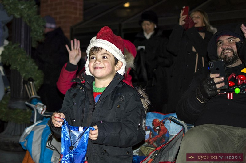 Boy Smiles during Kingsville Santa Claus Parade