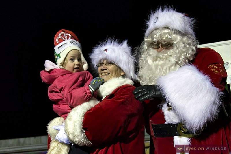 Young girl meets Santa and Mrs. Claus in Kingsville