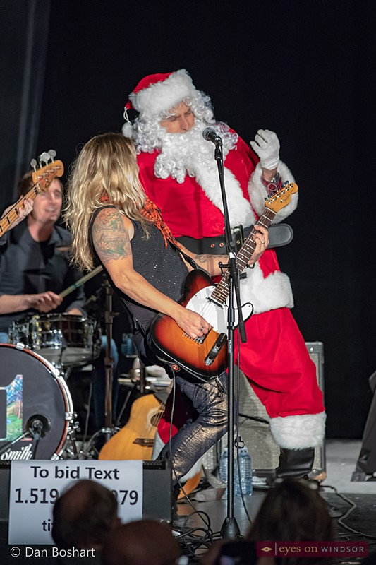Sarah Smith performing with Santa Claus