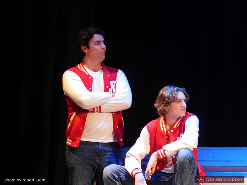 David Sivak (left) plays Ram Sweeney with Cavelle Doucet Lefebvre in the role of Kurt Kelly during a dress rehearsal of Cardinal Music's production of Heathers, the Musical.