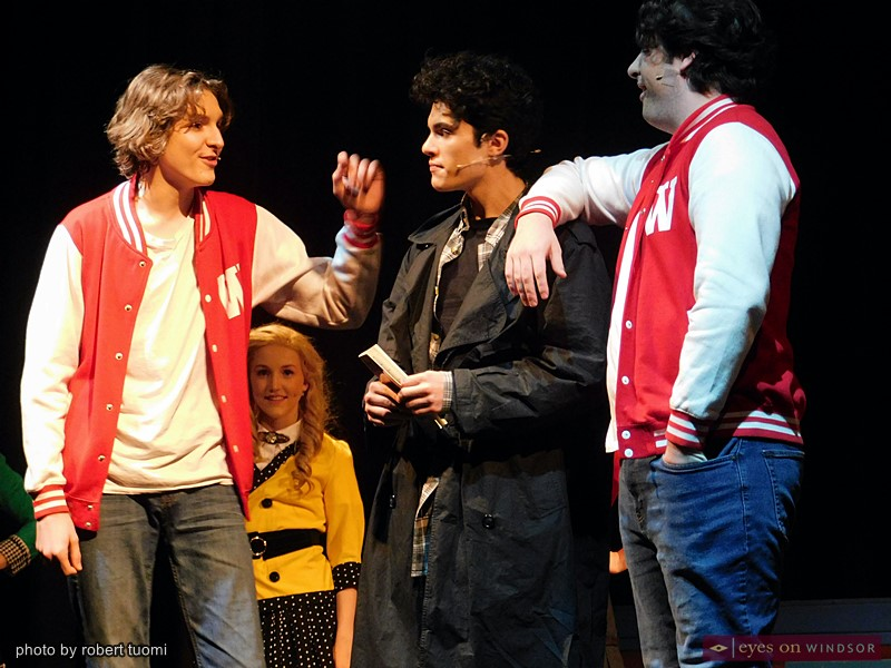 Nick Palazzolo stands between Cavelle Doucet Lefebvre (left) and David Sivak while Serena Barr looks on, in Cardinal Music's Heathers, the Musical