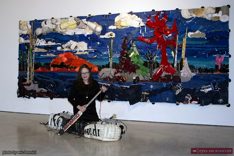 Artist Liz Pead at the Art Gallery of Windsor with her Saving Tom Thomson and Shut Out Canoe artwork.