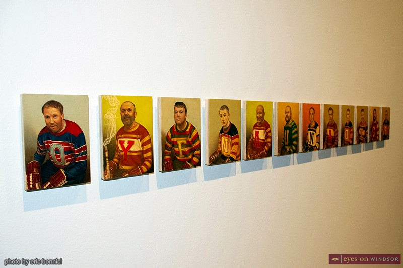 Hockey Player Portrait Paintings by Victor Romao on display at the Art Gallery of Windsor.