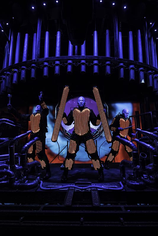Blue Man Group in Light Costumes