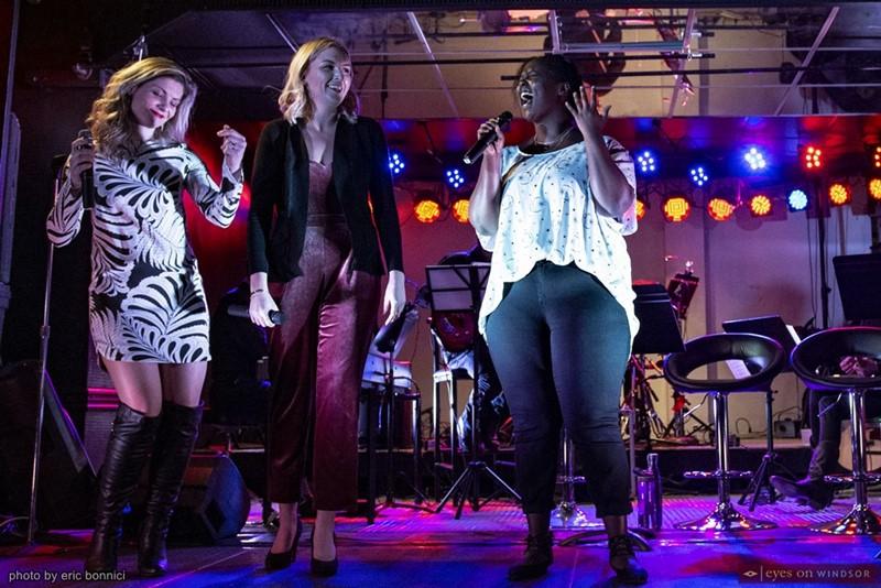 Sara Fontaine, Kaitlyn Karns, and Florine Ndimubandi performing.