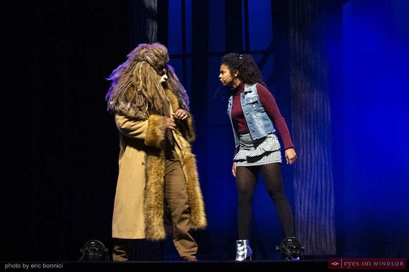 Dorothy (Rochelle Day, right) scolds the Cowardly Lion (Michael Rice)
