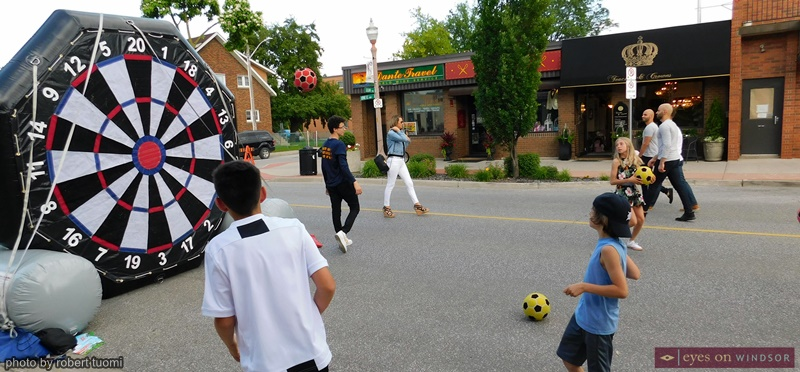 Youth kicking soccer balls during the Carrousel of the Nations Via Italia Italian Village