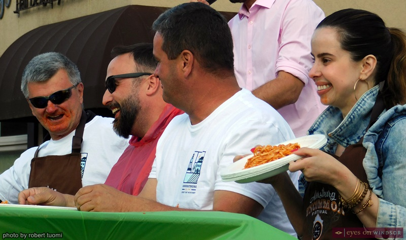 Spaghetti eating contest participants during the Via Italia Carrousel of the Nations celebration.