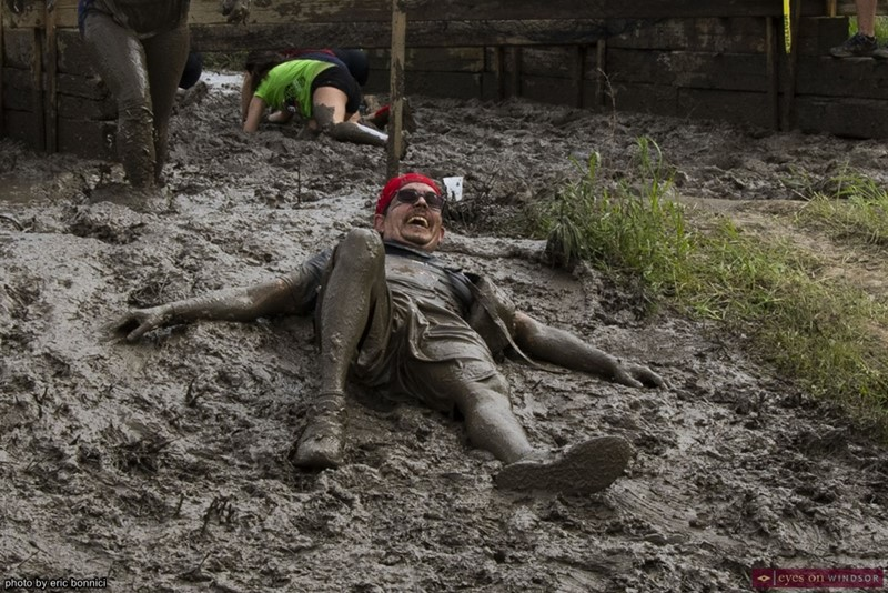 Heart Breaker Challenge Participant Laying in the Mud after Falling.