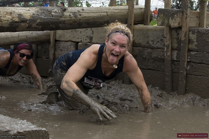 Heart Breaker Challenge Participants Crawling Through Mud