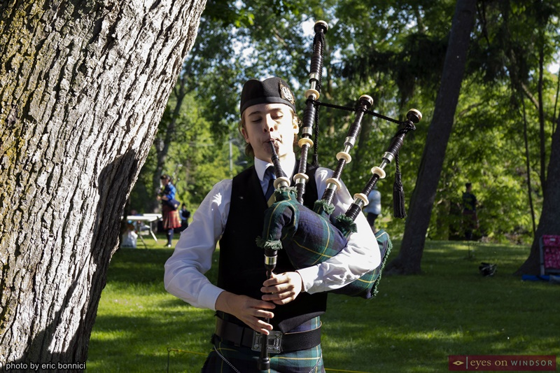 Bagpiper playing bagpipes at the Kingsville Highland Game