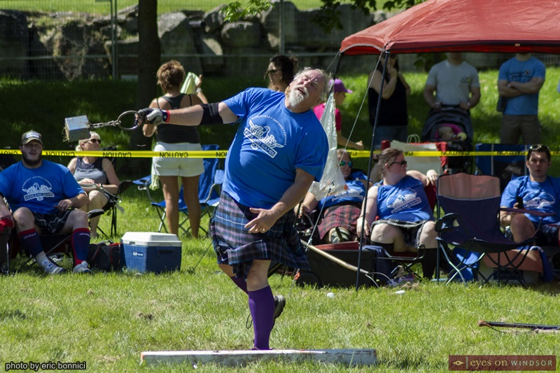 Man throwing a heavy object during Highland Kingsville Games