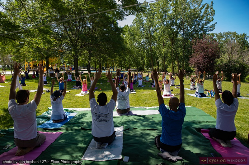 People Stretch in Windsor during International Yoga Day