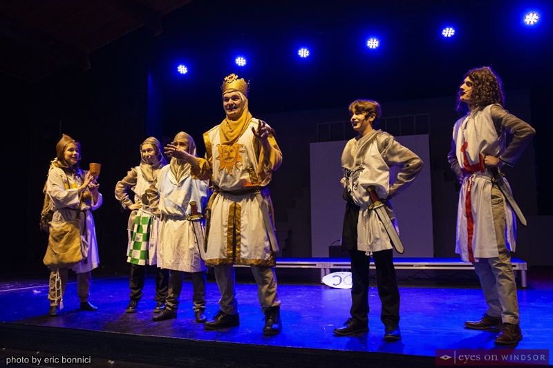 Calum McMillan as King Arthur celebrating with his knights