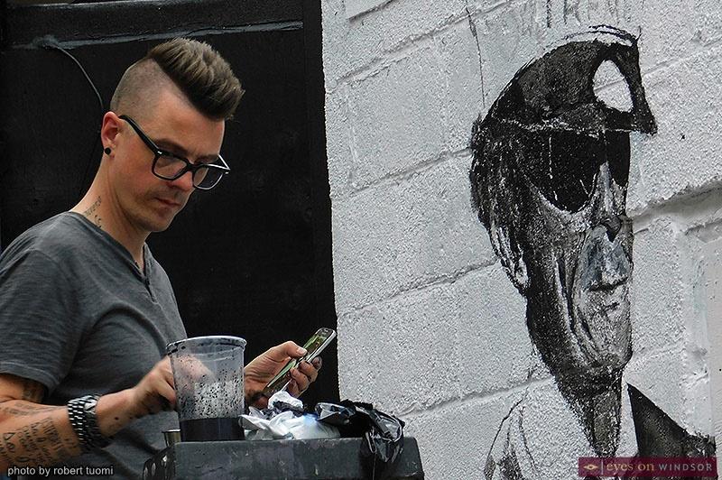 Artist Asaph Maurer Painting a Wall Mural during Walkerville Art Walk
