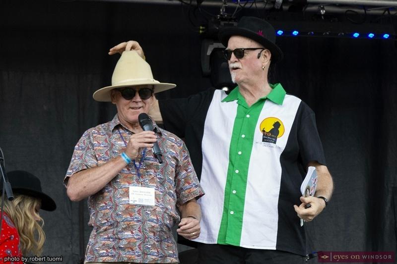 CBC Windsor's Tony Doucette and Folk Singer Songwriter Magaoo emceeing the Kingsville Folk Fest