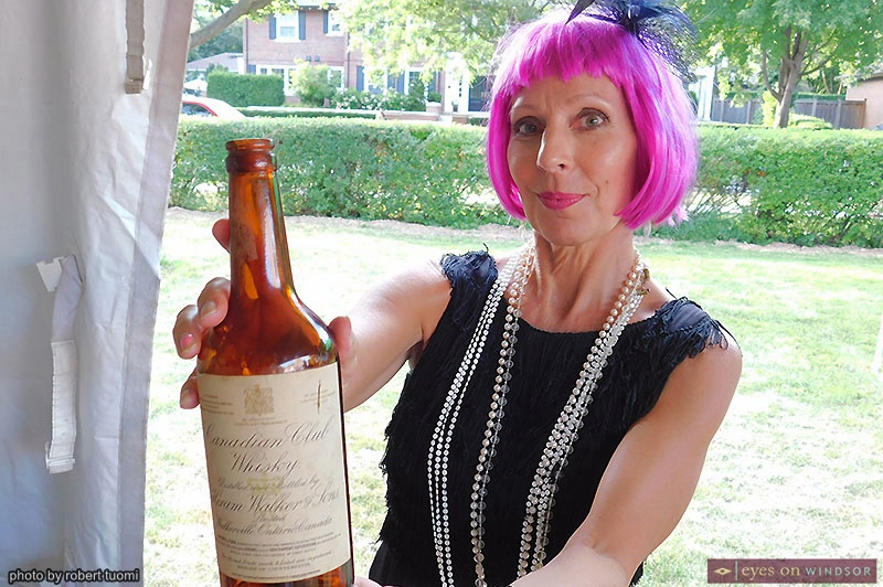 Elaine Weeks holding a vintage Canadian Club bottle