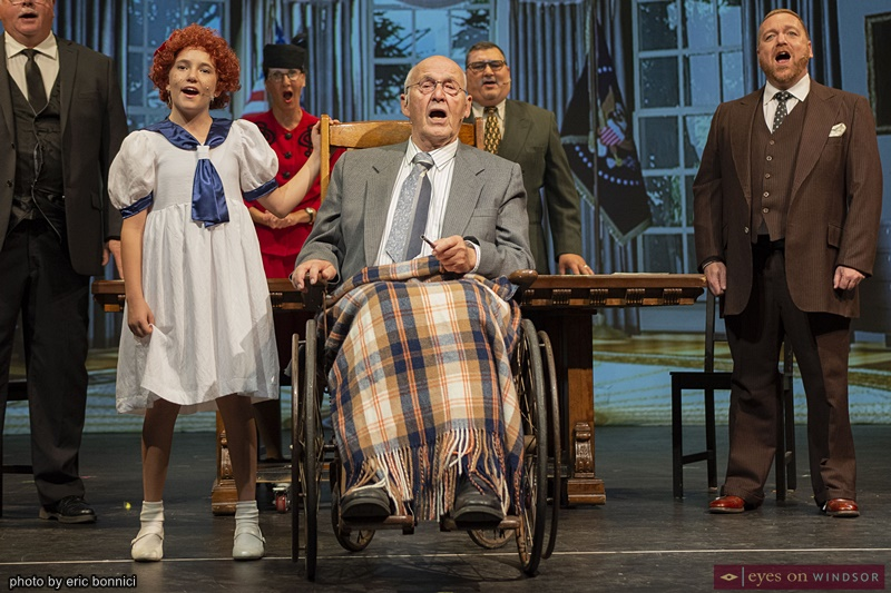 James Kneely singing in Annie The Musical by Cardinal Music Productions