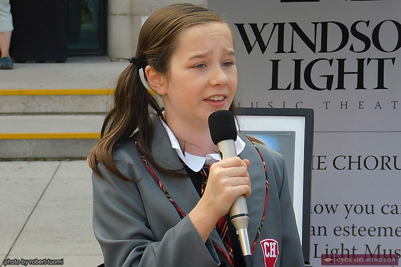 Josephine Cormier cast as Matilda singing during Open Streets Windsor