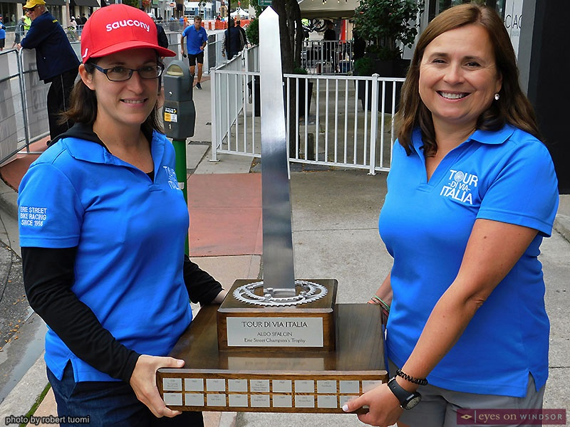 Becky Lazar and Sonya Vani holding the new Aldo Sfalcin Tour Di Via Italia trophy
