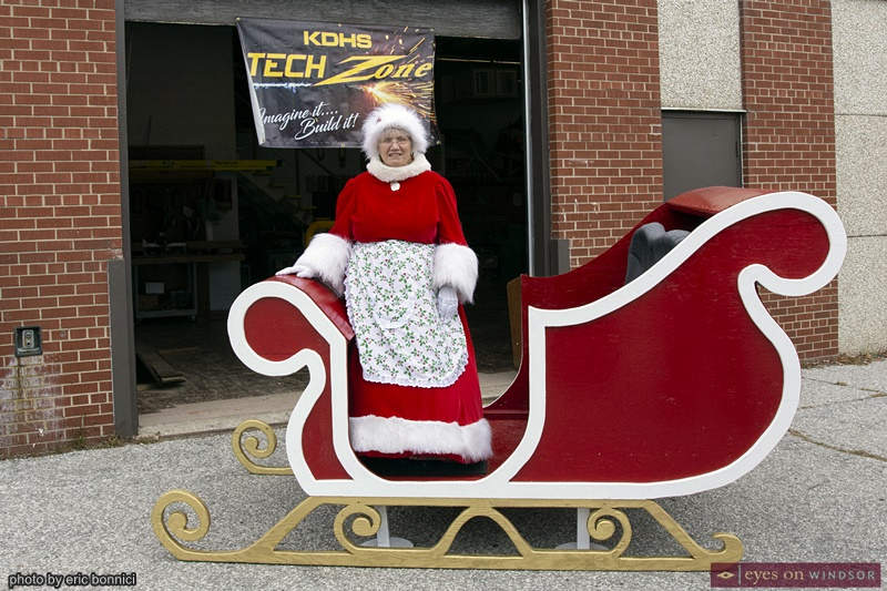 Mrs. Claus standing in Windsor Parade Corp.'s new Santa Claus Parade Sleigh