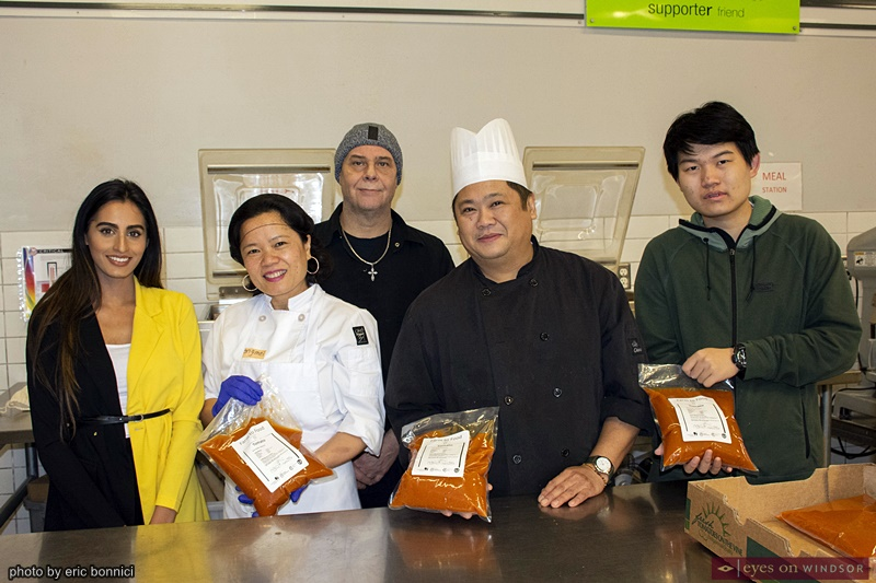 Unemployed Help Centre Community Kitchen Staff With Tomato Soup
