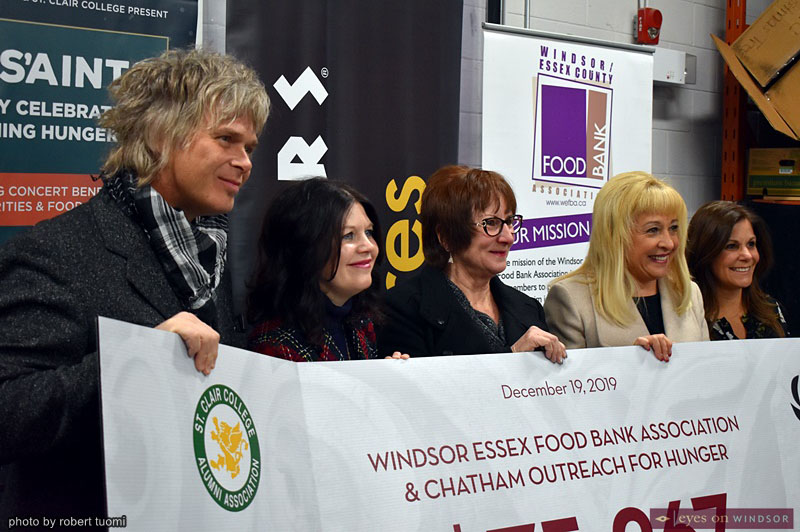 S'aints Sleighing Hunger Grand Total Cheque Presentation Announcement