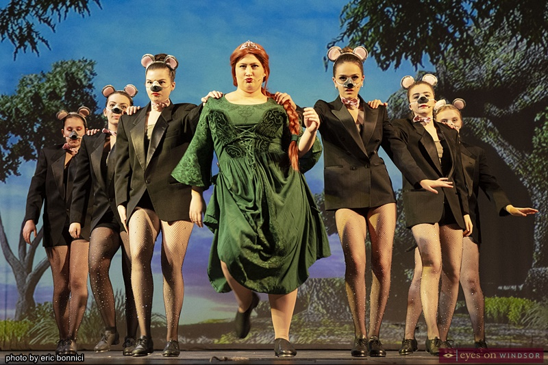 Nina Fasullo as Fiona dancing with cast members in the role of rats