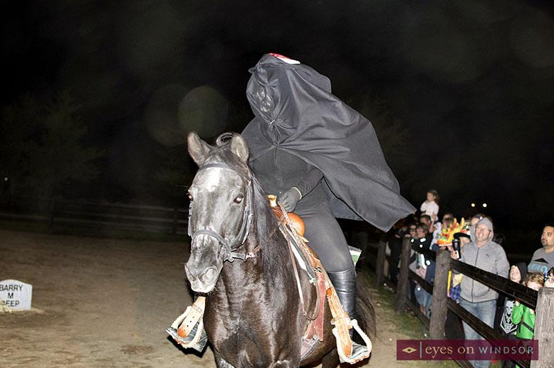 Halloween Spooktakular on The Farm WETRA   The crowd watches as the Headless Horseman rides his horse through the farm yard.