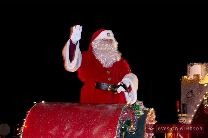 Santa waves to the crowd at the Town of Essex Santa Claus Parade.