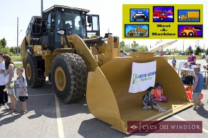 Children sitting in a bull dozer at Meet A Machine in Windsor, Ontario at the WFCU Centre.
