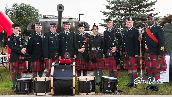 The Pipes and Drums of Essex and Kent Scottish at Trot With The Troops 2014