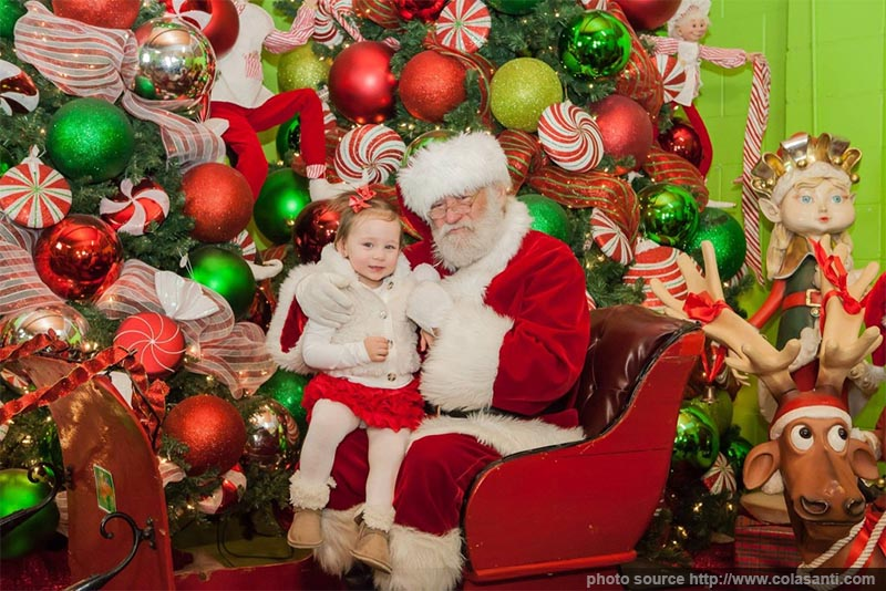 Santa visiting with children in his sleigh at Colasanti's Tropical Gardens