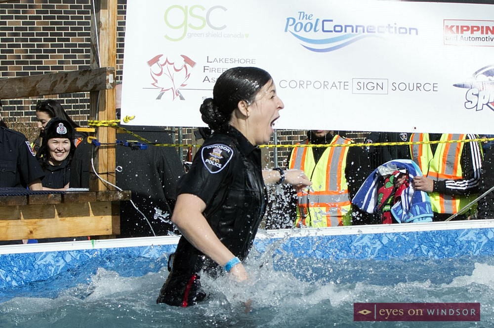 Windsor Police officer cold and wet after emerging from beneath Polar Plunge pool waters.