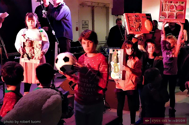 Children Holding Toys during Toys 4 Tots Fundraiser