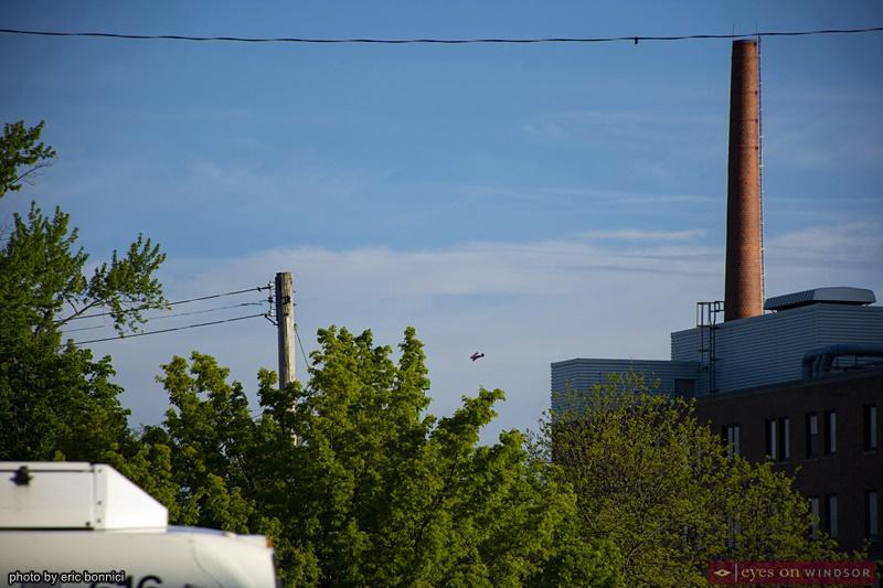 WACO plane flying over Windsor Regional Hospital