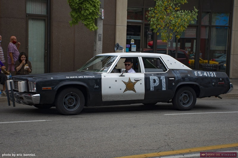 Blues Brothers impersonators and their vintage police car