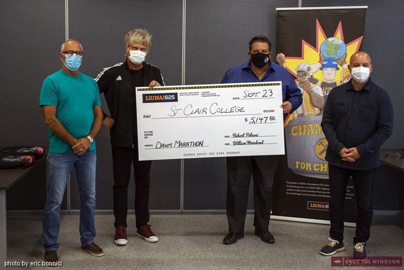 St. Clair College receiving donation from Jeff Burrows Half Drum Marathon