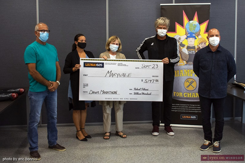 Maryvale Adolescent and Family Services receiving donation from Jeff Burrows Half Drum Marathon
