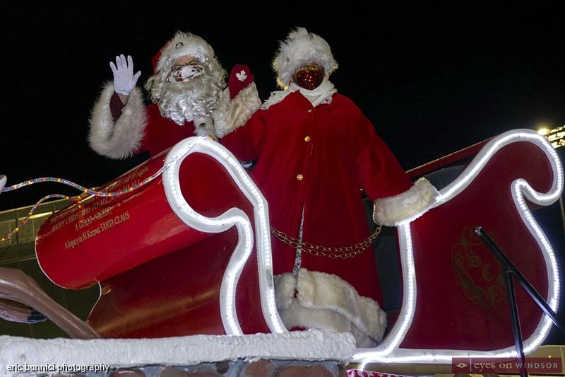 Santa and Mrs. Claus waving during Windsor Santa Claus Parade