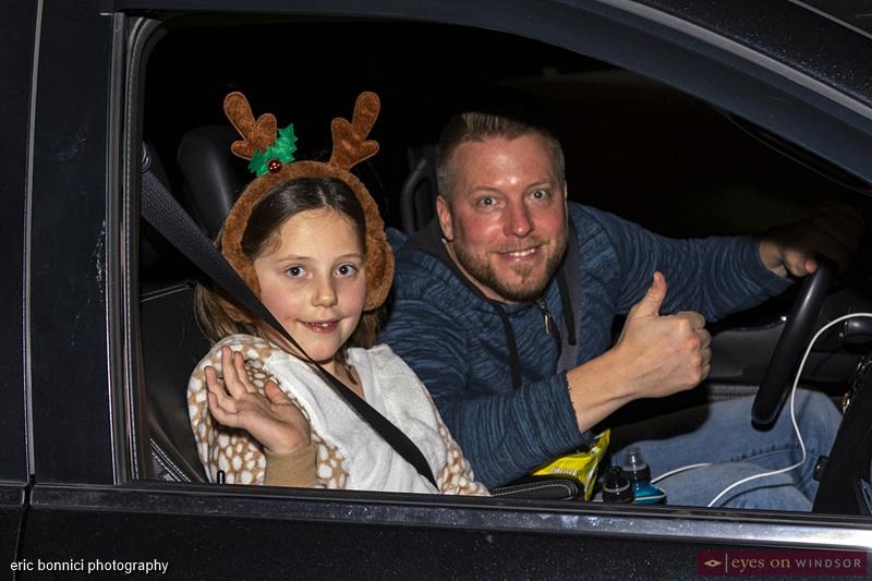 Spectators Steve Brown and Alyssa Brown, Windsor Santa Claus Parade