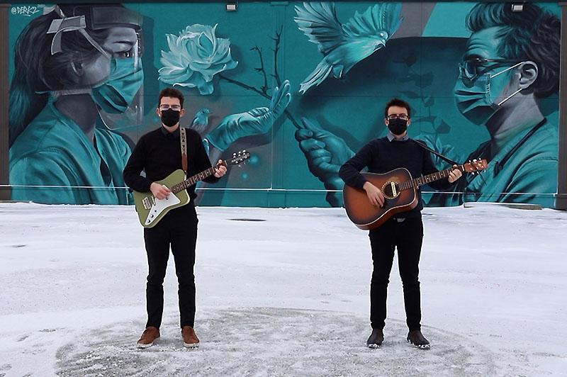 The Bishop Boys Perform Dark Days in front of Derkz Healthcare Mural